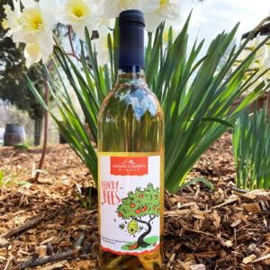 bottle of wine in flowers